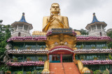 A grotesque Golden Buddha greets those arriving at Dambulla