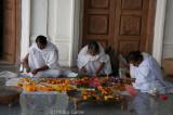 Women preparing garlands at the Shri Govindajee Mandir (temple)