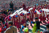 Massed dancers welcome the Karmapa Lama to Tawang