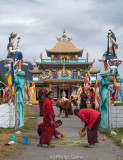 Monks at a monastery en route prepare to welcome the Karmapa Lama
