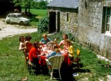 Hospitable French students lunching at their rented farmhouse in Brittany