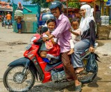 Indonesia: Family aboard a motorcycle, East Java