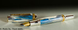 Canadian fountain pen / sterling sliver & titanium gold /  musk ox horn & intererence blue resin.
