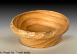 Bowl of wood with large growth rings.