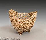 Turned, carved and pierced vessel with pyrographic highlights.