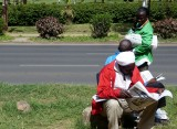Newspaper sellers take a break to read the paper on Uhuru Highway