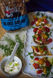 Daves Killer Blues Bread with Tomato Herb Salad