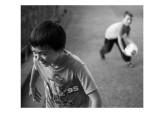 Joseph messing around with mate (throwing footballs, stones etc)