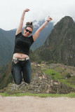 Fellow Traveler jumps for joy at Machu Picchu
