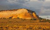Cliff of Navajo Sandstone and rainbow, White Pocket, Vermilion Cliffs National Monument, AZ