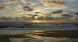 Sunrise kissing the shore line
