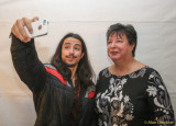 Alex creating a selfie with a fan