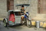 Tricycle and driver