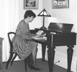 Denise Bristow at desk - 154 Norfolk St. S. Simcoe
