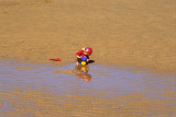 Child Playing on the Sand