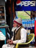Old Muslim Gentleman Drinking Tea With Friends