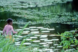 Boy in Pink Trying To Fish
