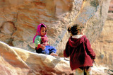 Children Playing On The Rocks Outside Their Homes