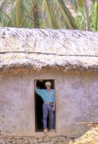 Traditional Man At The Door Of His Traditional House