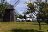 6.  The Gristmill on the Eastham Green, a craft show in progress.