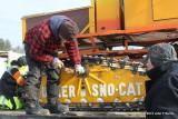 Tucker Sno-Cat axle under repair