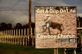 An ad for the Cowboy Church, a few miles west and up from Paia