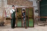Carpenter with window frame - Hisor