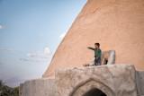 Boy on cistern pointing - Evaz