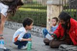 Children see the beggar