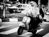 Man and woman on motorcycle - Tehran