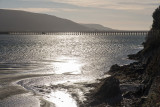 Barmouth Viaduct backlit by winter sun