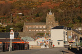 Barmouth church, railway line and a lady in red.