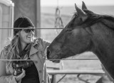 Molly Murphy interviewing and photographing a rodeo participant (2013)