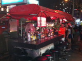 Makeshift bar by the entrance to Soi Cowboy