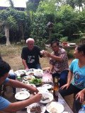 Lunch and a crate of BeerLao with my tuktuk drivers cheerful family
