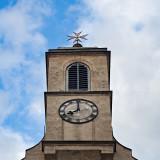Clock Under Maltese Cross