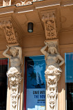 Caryatids With A Poster