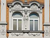 Caryatid Between The Windows