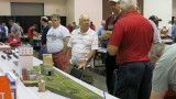 Chet French, center, explaining how the Allied Mills layout should be run.