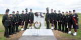 Military honour guard the Sackets Harbor Crown monument