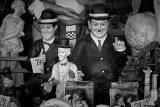 Laurel & Hardy behind a dirty vindue
