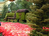 Pointsettia Display inside the Bellagio Atrium along with a train made out of greenery