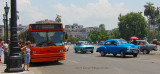 A Bus and cars in the Business District of Havana