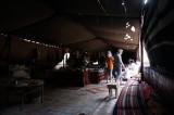inside a bedouin merchant's tent, an Italian tour group bargains...