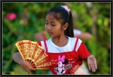 A Young Girl during a Legong Dance Lesson Open air.