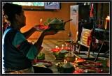 Offerings. Vat Si Muang. Vientiane.