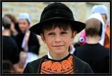 The Little Round Black Hat.
