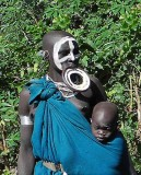 Surma woman with a hole in her lip plate to make it lighter;  south-western Ethiopia.