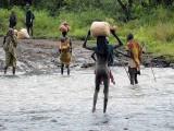 Surma people crossing the Kibish River;  south-western Ethiopia.