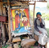 Priest collecting money for the renovation of a church near Gondar. Ethiopia.